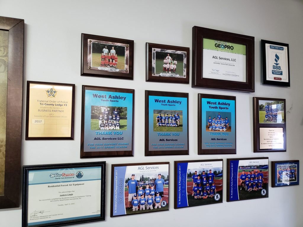 wall of pictures showing community involvement by agl air charleston sc heating and air repair company